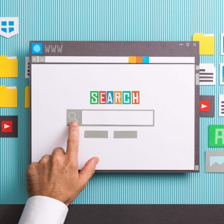 Search engine home page with search bar on a browser window, a user is entering a query, collage and paper cut composition